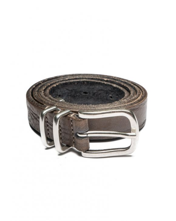LEATHER METAL TIPPED BELT IN MUD